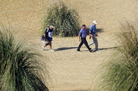 PALM DESERT, CA - JANUARY 20:  Robert Gamez and D. J. Trahan makes their way to the fourth green during the fifth round of the 49th Bob Hope Chrysler Classic at the Classic Club Course on January 20, 2008 in Palm Desert, California.  (Photo by Harry How/Getty Images)