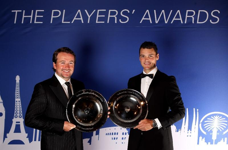 VIRGINIA WATER, ENGLAND - MAY 24:  Graeme McDowell of Northern Ireland (L) and Martin Kaymer of Germany pose with their jointly won European Tour Golfer of the Year Awards during the European Tour Dinner at The Wentworth Club on May 24, 2011 in Virginia Water, England.  (Photo by Andrew Redington/Getty Images)