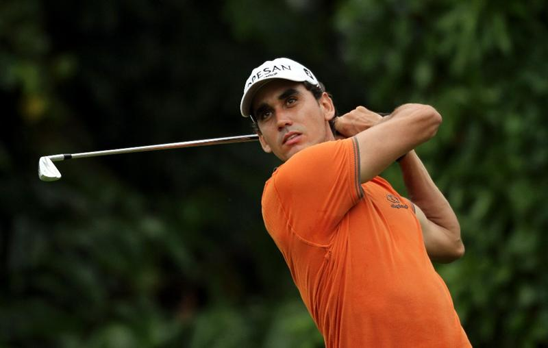 SINGAPORE - NOVEMBER 14: Rafael Cabrera-Bello of Spain watches his tee shot on the 8th hole during the Final Round of the Barclays Singapore Open held at the Sentosa Golf Club on November 14, 2010 in Singapore, Singapore.  (Photo by Stanley Chou/Getty Images)