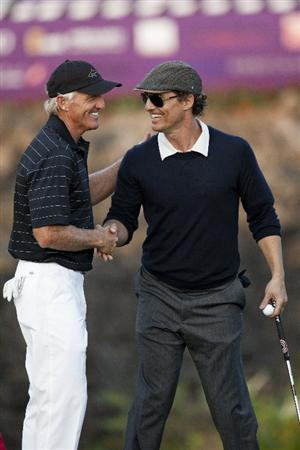 HAIKOU, CHINA - OCTOBER 30: Golf Legend Greg Norman of Australia (L) and Hollywood actor Matthew McConaughey shake hands during day four of the Mission Hills Start Trophy tournament at Mission Hills Resort on October 30, 2010 in Haikou, China. The Mission Hills Star Trophy is Asia's leading leisure liflestyle event which features Hollywood celebrities and international golf stars.  (Photo by Athit Perawongmetha/Getty Images for Mission Hills)