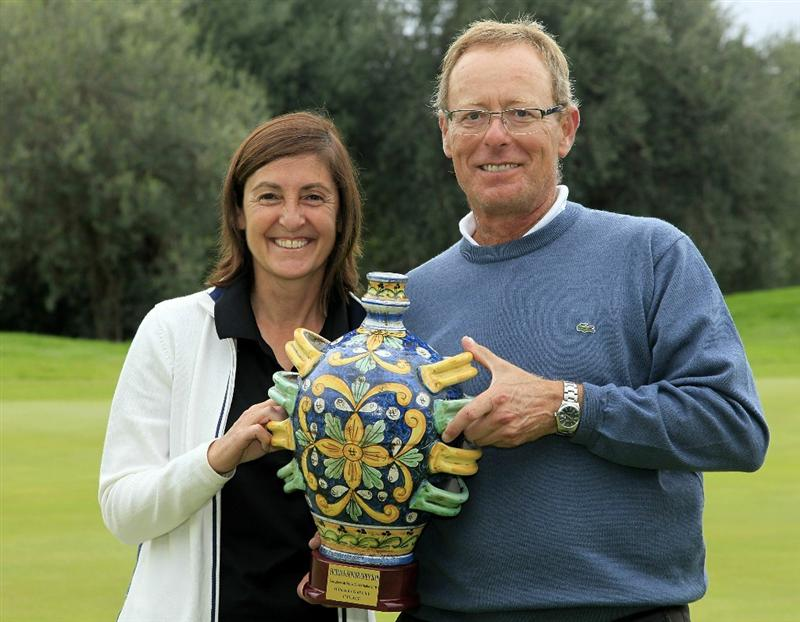 CATANIA, ITALY - OCTOBER 24:  Yolanda and Domingo Hospital of Spain pose with the trophy after winning the playoff to Horacio Carbonetti of Argentina during the final round of the Sicilian Senior Open played at Il Picciolo Golf Club on October 24, 2010 in Catania, Italy.  (Photo by Phil Inglis/Getty Images)