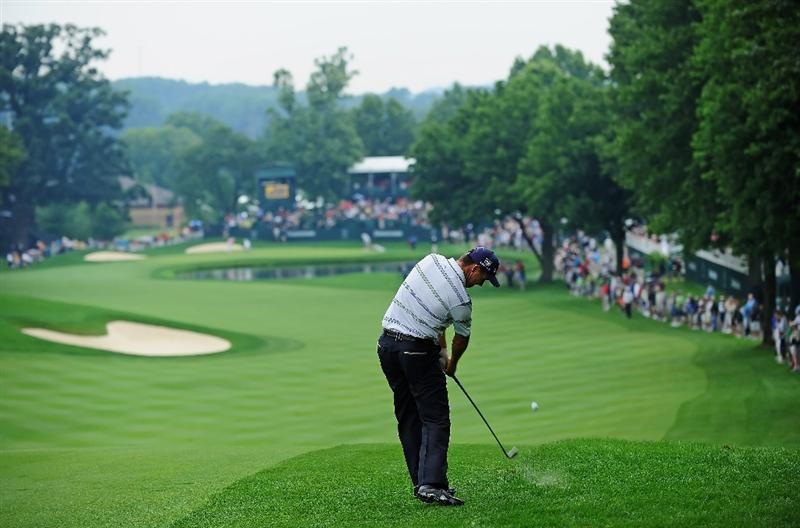 AKRON, OH - AUGUST 08: Padraig Harrington of Ireland plays his approach shot on the 16th hole during the third round of the World Golf Championship Bridgestone Invitational on August 8, 2009 at Firestone Country Club in Akron, Ohio. (Photo by Stuart Franklin/Getty Images)
