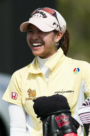 CHON BURI, THAILAND - FEBRUARY 18:  Pornanong Phatlum of Thailand smiles on the 16th tee during day two of the LPGA Thailand at Siam Country Club on February 18, 2011 in Chon Buri, Thailand.  (Photo by Victor Fraile/Getty Images)