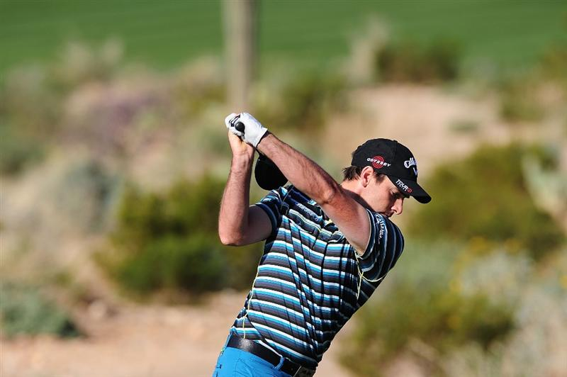 MARANA, AZ - FEBRUARY 18:  Oliver Wilson of England plays a shot on the second hole during round two of the Accenture Match Play Championship at the Ritz-Carlton Golf Club on February 18, 2010 in Marana, Arizona.  (Photo by Stuart Franklin/Getty Images)
