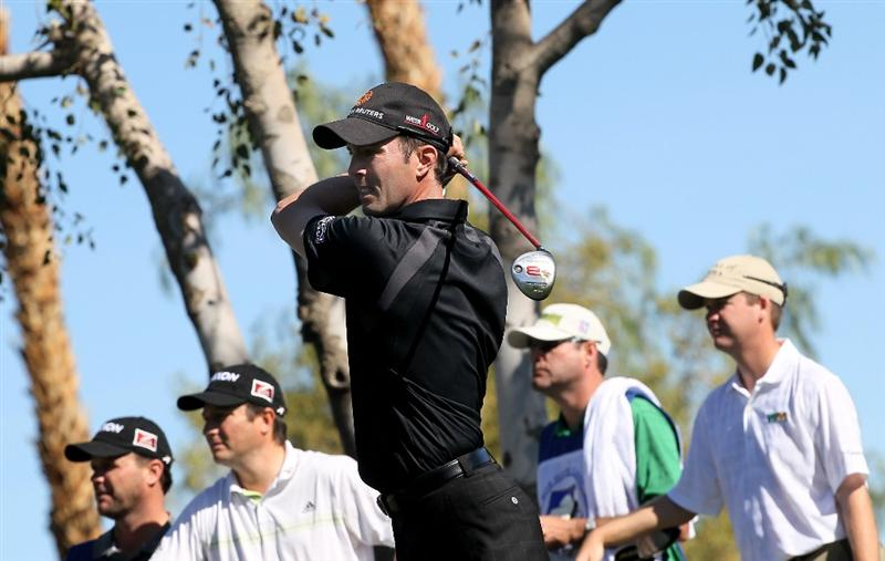 LA QUINTA, CA - JANUARY 25:  Mike Weir of Canada hits his tee shot on the fourth hole at the Palmer Private course at PGA West during the final round of the Bob Hope Classic on January 25, 2010 in La Quinta, California.  (Photo by Stephen Dunn/Getty Images)