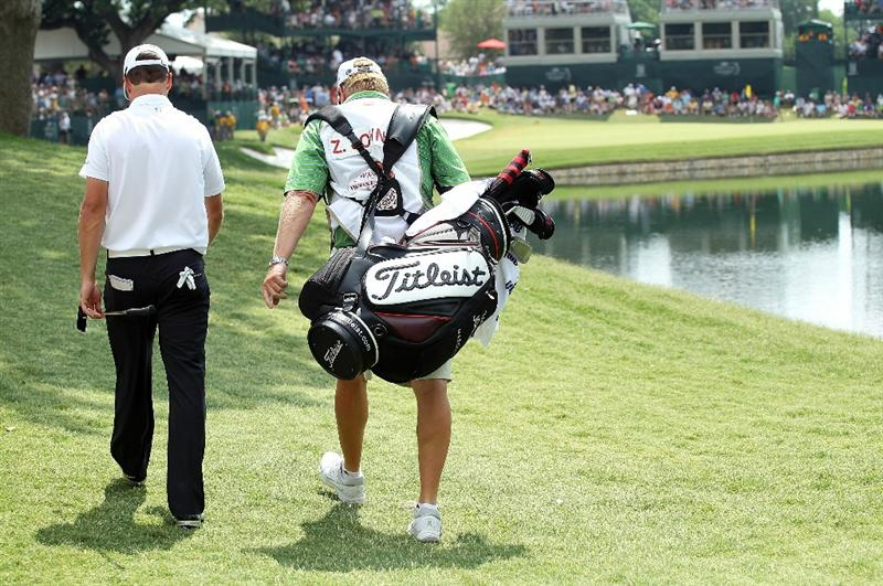 FT. WORTH, TX - MAY 30:   Zach Johnson walks with his caddie Damon Green to the 13th green during the final round of the 2010 Crowne Plaza Invitational at the Colonial Country Club on May 30, 2010 in Ft. Worth, Texas.  (Photo by Scott Halleran/Getty Images)
