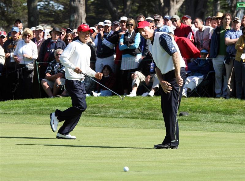 SAN FRANCISCO - OCTOBER 09:  Jim Furyk of the USA Team just misses a birdie as his partner Anthony Kim reacts at the 9th hole during the Day Two Fourball Matches in The Presidents Cup at Harding Park Golf Course on October 9, 2009 in San Francisco, California  (Photo by David Cannon/Getty Images)