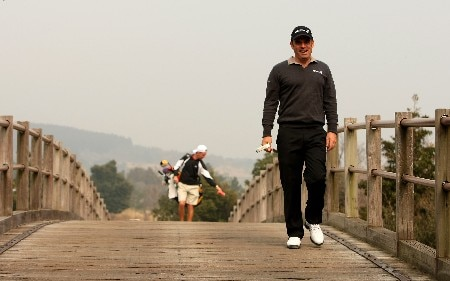 JEJU, SOUTH KOREA - MARCH 12:  Paul McGinley of Ireland walks across a bridge during the Pro-Am for the Ballantine's Championship at Pinx Golf Club on March 12, 2008 on Jeju Island, South Korea.  (Photo by Richard Heathcote/Getty Images)