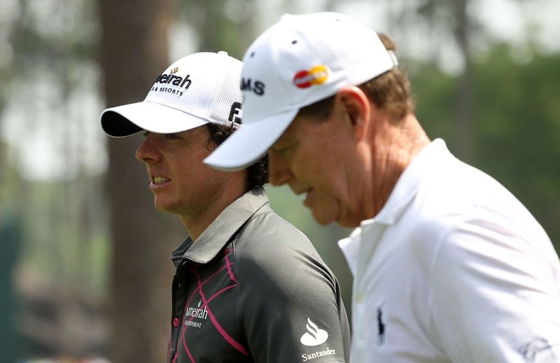 Rory McIlroy (L) and Tom Watson