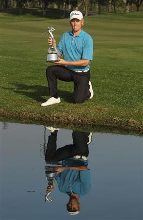 NEW DELHI, INDIA - FEBRUARY 14:  Andrew Dodt of Australia celebrates with the trophy after winning Final Round of the Avantha Masters held at The DLF Golf and Country Club on February 14, 2010 in New Delhi, India.  (Photo by Ian Walton/Getty Images)
