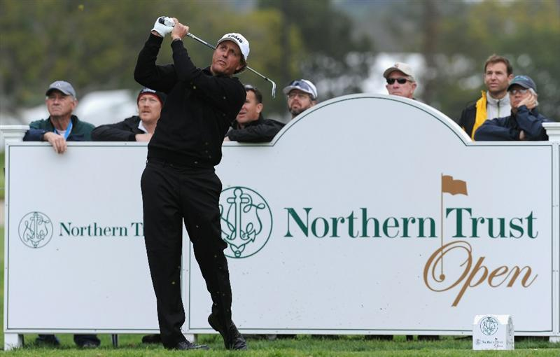 PACIFIC PALISADES, CA - FEBRUARY 18:  Phil Mickelson plays his tee shot on the 14th hole during the second round of the Northern Trust Open at Riviera Country Club on February 18, 2011 in Pacific Palisades, California.  (Photo by Stuart Franklin/Getty Images)