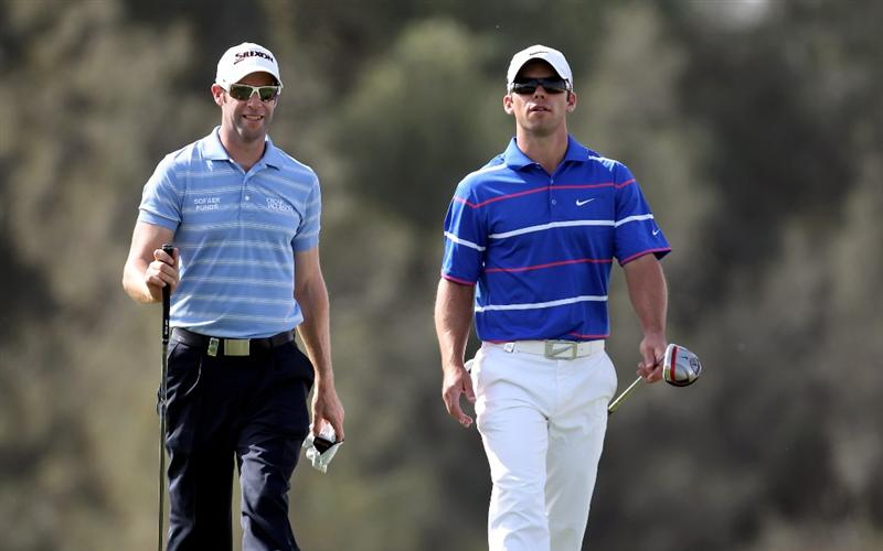 DOHA, QATAR - JANUARY 31:  Bradley Dredge of Wales and Paul Casey of England walk off of the 6th tee during the final round of The Commercialbank Qatar Masters at The Doha Golf Club on January 31, 2010 in Doha, Qatar.  (Photo by Ross Kinnaird/Getty Images)