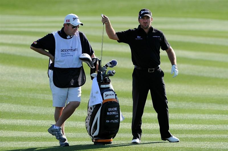 MARANA, AZ - FEBRUARY 24:  Graeme McDowell of Northern Ireland (R) pulls a club from his bag as caddie Ken Comboy looks on during the second round of the Accenture Match Play Championship at the Ritz-Carlton Golf Club on February 24, 2011 in Marana, Arizona.  (Photo by Stuart Franklin/Getty Images)