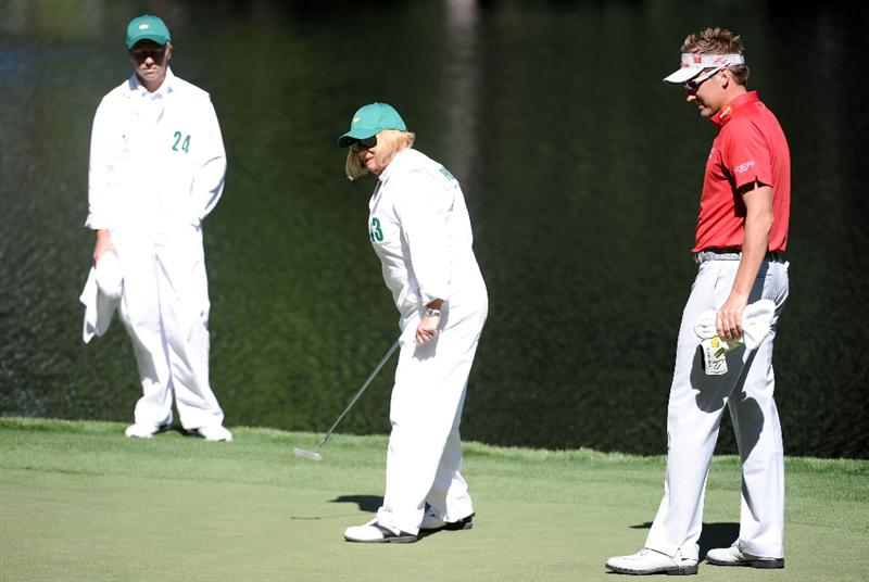 AUGUSTA, GA - APRIL 06:  Ian Poulter waits with his mother Theresa on the ninth green during the Par 3 Contest prior to the 2011 Masters Tournament at Augusta National Golf Club on April 6, 2011 in Augusta, Georgia.  (Photo by Harry How/Getty Images)