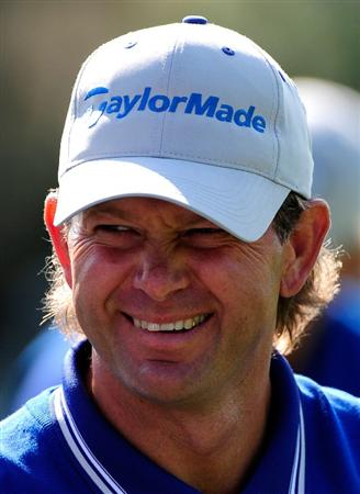 ORLANDO, FL - MARCH 23:  Retief Goosen of South Africa smiles during the second day's play of the Tavistock Cup at Isleworth Golf and Country Club on March 23, 2010 in Orlando, Florida.  (Photo by Sam Greenwood/Getty Images)