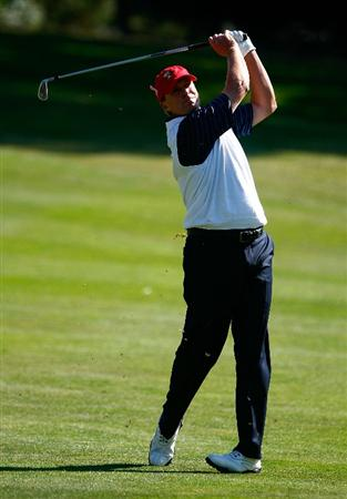 SAN FRANCISCO - OCTOBER 09:  Steve Stricker of the USA Team watches his approach shot on the 12th hole during the Day Two Fourball Matches of The Presidents Cup at Harding Park Golf Course on October 9, 2009 in San Francisco, California.  (Photo by Scott Halleran/Getty Images)