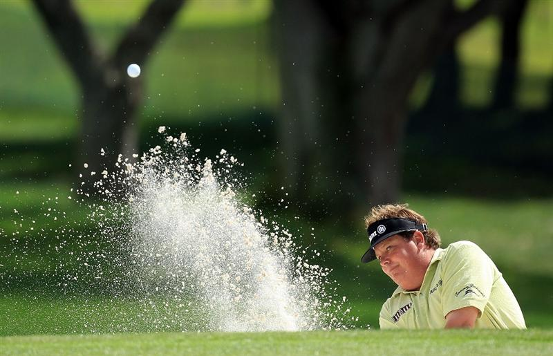 ORLANDO, FL - MARCH 26:  Tim Herron of the USA plays his third shot at the 15th hole during the second round of the Arnold Palmer Invitational presented by Mastercard at the Bayhill Club and Lodge, on March 26, 2010 in Orlando, Florida.  (Photo by David Cannon/Getty Images)