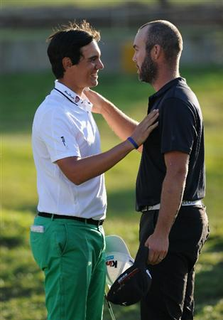 CASTELLON DE LA PLANA, SPAIN - OCTOBER 24:  Matteo Manassero of Italy is congraulated by playing partner Christian Nilsson of Sweden on the 18th hole during the final round of the Castello Masters Costa Azahar at the Club de Campo del Mediterraneo on October 24, 2010 in Castellon de la Plana, Spain.  (Photo by Stuart Franklin/Getty Images)