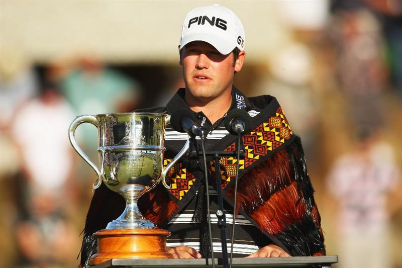 QUEENSTOWN, NEW ZEALAND - MARCH 15:  Alex Prugh of the USA makes a speech after accepting the winners trophy during day four of the New Zealand Men's Open Championship at The Hills Golf Club on March 15, 2009 in Queenstown, New Zealand.  (Photo by Phil Walter/Getty Images)