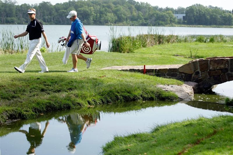 CHASKA, MN - AUGUST 14:  David Toms walks with his caddie Scott Gneiser on the 16th hole during the second round of the 91st PGA Championship at Hazeltine National Golf Club on August 14, 2009 in Chaska, Minnesota.  (Photo by Jamie Squire/Getty Images)