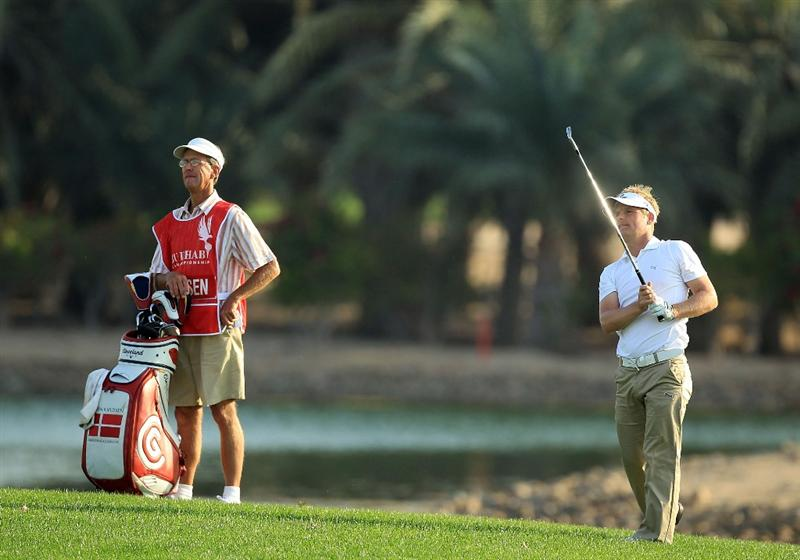 ABU DHABI, UNITED ARAB EMIRATES - JANUARY 21:  Soren Kjeldsen of Denmark plays his second shot at the par 5, 18th hole during the first round of The Abu Dhabi Golf Championship at Abu Dhabi Golf Club on January 21, 2010 in Abu Dhabi, United Arab Emirates.  (Photo by David Cannon/Getty Images)
