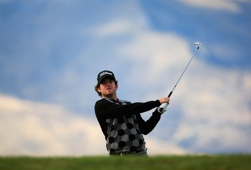 QUEENSTOWN, NEW ZEALAND - MARCH 13: Josh Geary of New Zealand plays an approach shot on the 18th hole during day two of the New Zealand Men's Open Championship at The Hills Golf Club on March 13, 2009 in Queenstown, New Zealand.  (Photo by Phil Walter/Getty Images)