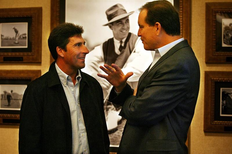 ST AUGUSTINE, FL - NOVEMBER 02:  Golfer Jose Maria Olazabal (L) and sportscaster Jim Nantz chat prior to the World Golf Hall of Fame induction ceremonys on November 2, 2009 in St Augustine, Florida.  (Photo by Marc Serota/Getty Images for the World Golf Hall of Fame)