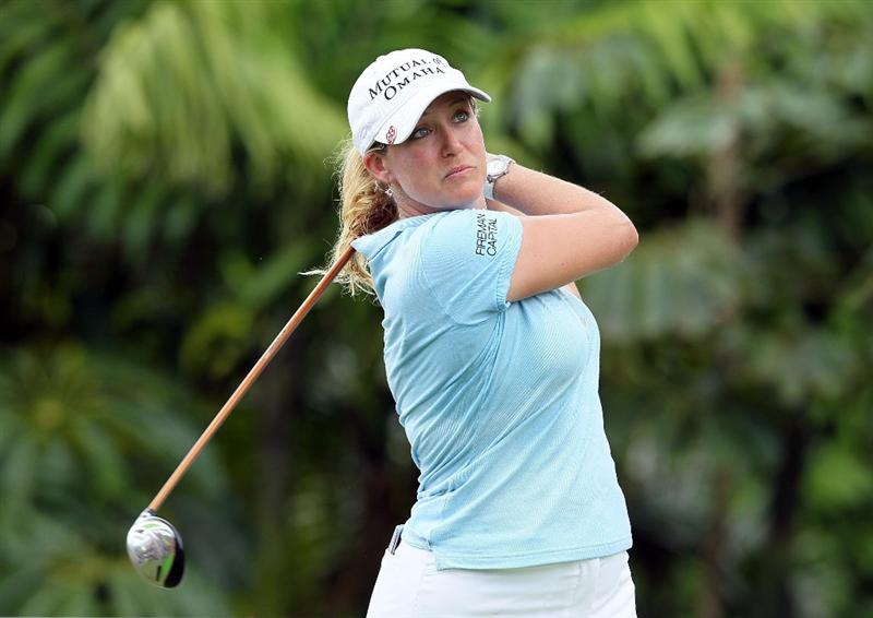 SINGAPORE - FEBRUARY 25: Cristie Kerr of the USA hits her tee shot on the 7th hole during the first round of the HSBC Women's Champions at Tanah Merah Country Club on February 25, 2010 in Singapore, Singapore.  (Photo by Andy Lyons/Getty Images)