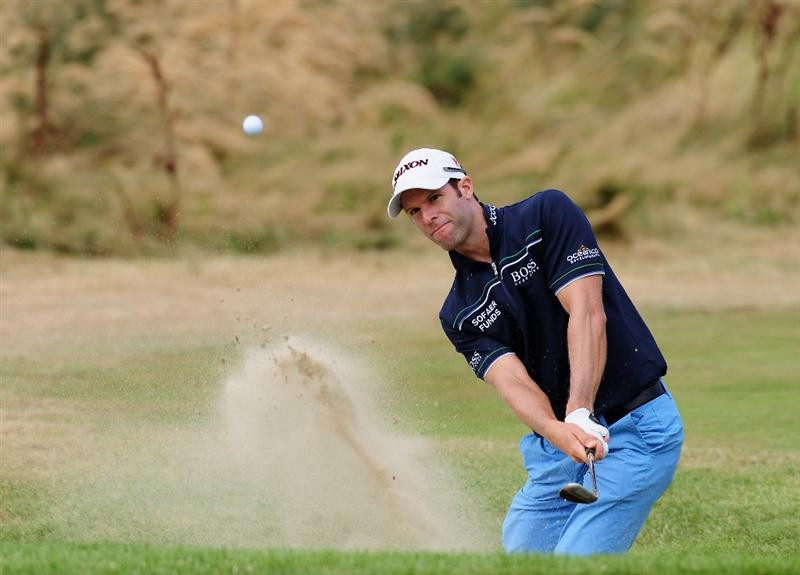 ZANDVOORT, NETHERLANDS - AUGUST 21: Bradley Dredge of Wales plays his bunker shot on the 13th hole during the second round of The KLM Open at Kennemer Golf & Country Club on August 21, 2009 in Zandvoort, Netherlands.  (Photo by Stuart Franklin/Getty Images)