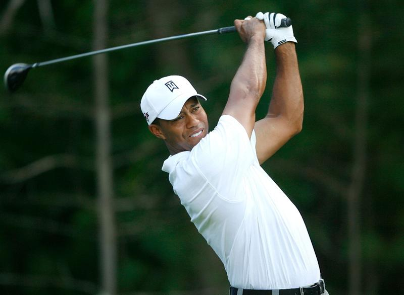 NORTON, MA - SEPTEMBER 5:  Tiger Woods hits a tee shot during the second round of the Deutsche Bank Championship held at TPC Boston on September 5, 2009 in Norton, Massachusetts. (Photo by Jim Rogash/Getty Images)
