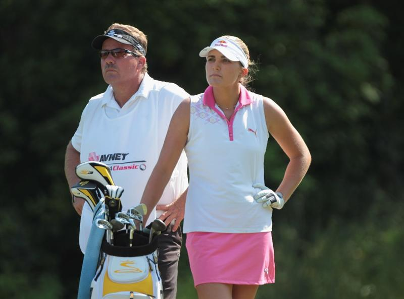 MOBILE, AL - APRIL 30:  Alexis Thompson waits on the 18th tee alongside her father/caddie Scottduring the third round of the Avnet LPGA Classic at the Crossings Course at the Robert Trent Jones Trail at Magnolia Grove on April 30, 2011 in Mobile, Alabama.  (Photo by Scott Halleran/Getty Images)