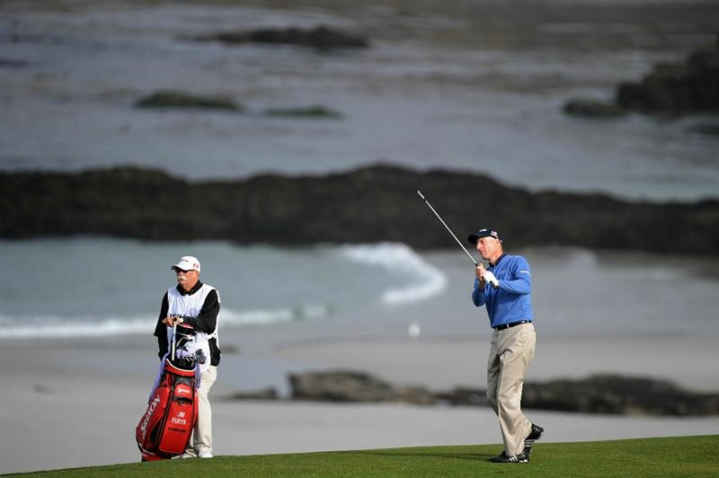 PEBBLE BEACH, CA - JUNE 17:  Jim Furyk (R) hits a shot on the tenth hole as he caddie Mike Cowan looks on during the first round of the 110th U.S. Open at Pebble Beach Golf Links on June 17, 2010 in Pebble Beach, California.  (Photo by Harry How/Getty Images)