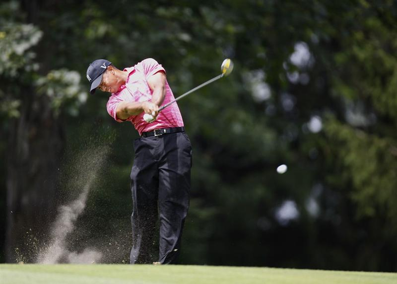GRAND BLANC, MI - JULY 30:  Tiger Woods hits from the first fairway during the first round of the Buick Open at Warwick Hills Golf and Country Club on July 30, 2009 in Grand Blanc, Michigan.  (Photo by Gregory Shamus/Getty Images)