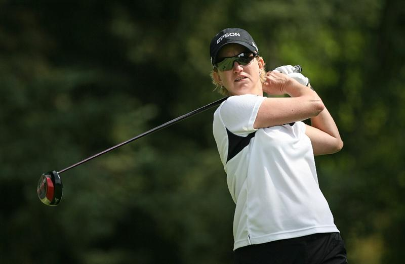 CALGARY, AB - SEPTEMBER 05 : Karrie Webb of Australia hits her tee shot on the ninth hole during the third round of the Canadian Women's Open at Priddis Greens Golf & Country Club on September 5, 2009 in Calgary, Alberta, Canada. (Photo by Hunter Martin/Getty Images)