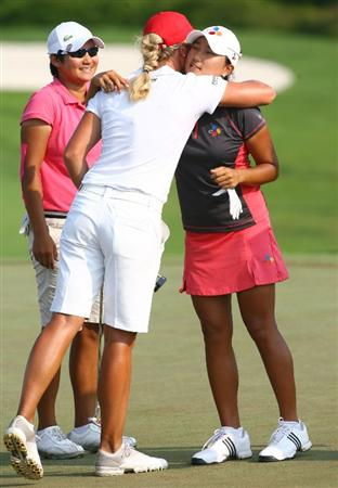 HAIKOU, CHINA - OCTOBER 24: (CHINA OUT) Yani Tseng (L) of Chinese Taipei, Suzann Pettersen (C) of Norway and Seon Hwa Lee of South Korea hug each other on the 10th hole during day one of the Grand China Air LPGA 2008 on October 24, 2008 in Haikou of Hainan Province, China. (Photo by China Photos/Getty Images)