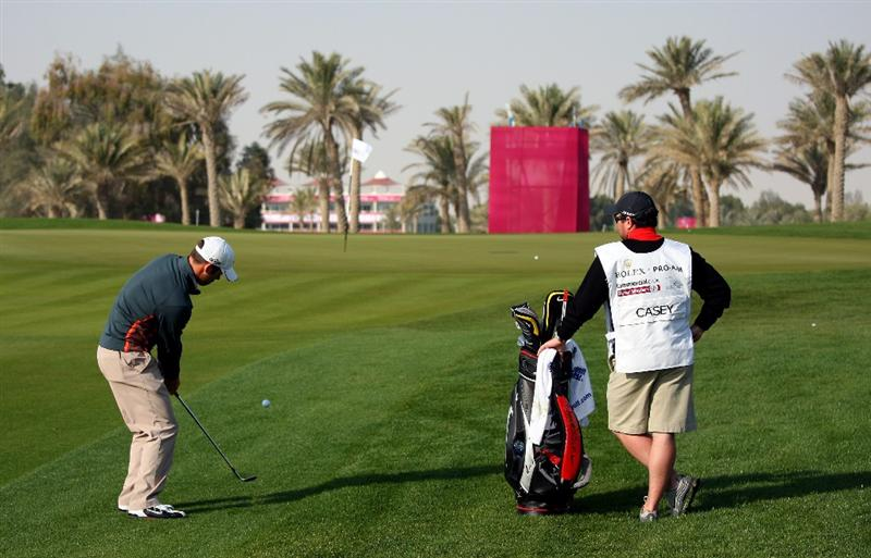 DOHA, QATAR - JANUARY 21:  Paul Casey of England plays his third shot on the fifth hole during the Pro Am for the Commercialbank Qatar Masters at Doha Golf Club on January 21, 2009 in Doha, Qatar.  (Photo by Andrew Redington/Getty Images)