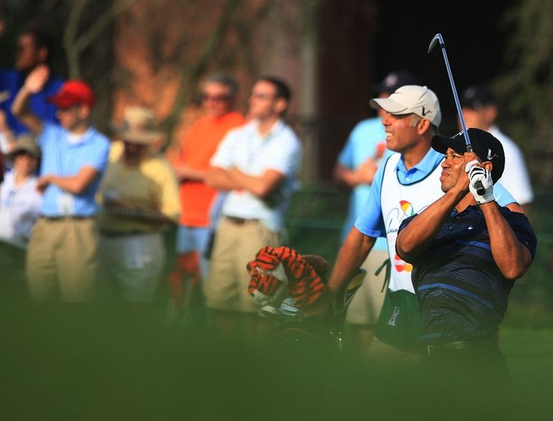 ORLANDO, FL - MARCH 27:  Tiger Woods hits his approach shot on the 13th hole as his caddie Steve Williams looks on during the second round of the Arnold Palmer Invitational at the Bay Hill Club & Lodge on March 27, 2009 in Orlando, Florida.  (Photo by Scott Halleran/Getty Images)