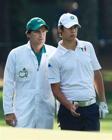 AUGUSTA, GA - APRIL 07:  Matteo Manassero of Italy, who is set to become the youngest ever competitor at the Masters, looks over a green with his caddie Alberto Binaghi during a practice round prior to the 2010 Masters Tournament at Augusta National Golf Club on April 7, 2010 in Augusta, Georgia.  (Photo by David Cannon/Getty Images)