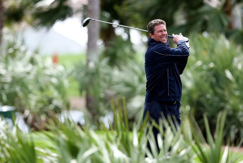 PALM BEACH GARDENS, FL - MARCH 03:  Hall-of-Fame NFL quarterback Dan Marino of the Miami Dolphins follows his tee shot on the second hole during the Honda Classic Kenny G Gold Pro-Am at PGA National Resort And Spa on March 3, 2010 in Palm Beach Gardens, Florida.  (Photo by Doug Benc/Getty Images)