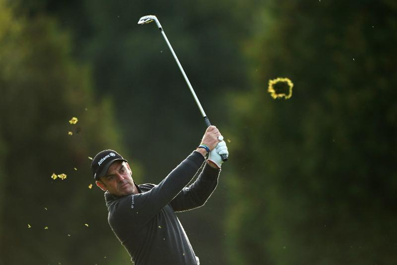 CRANS, SWITZERLAND - SEPTEMBER 02:  Paul McGinley of Ireland plays his second shot into the 10th green during the first round of The Omega European Masters at Crans-Sur-Sierre Golf Club on September 2, 2010 in Crans Montana, Switzerland.  (Photo by Warren Little/Getty Images)