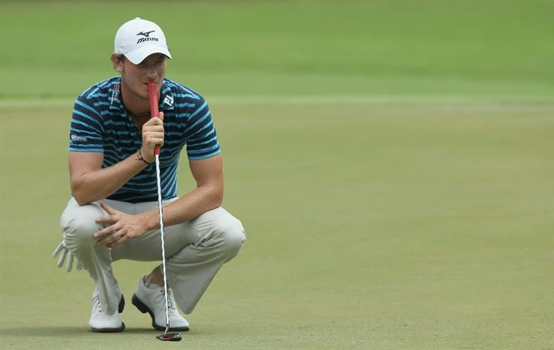 SINGAPORE - NOVEMBER 13: Chris Wood of England lines up for a putt on the 11th hole during the Third Round of the Barclays Singapore Open held at the Sentosa Golf Club on November 13, 2010 in Singapore, Singapore.  (Photo by Stanley Chou/Getty Images)