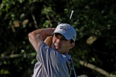 Mike Weir sends his tee flying on the fifth   hole during third-round competition March 5, 2005  at the Ford Championship at Doral in Miami.