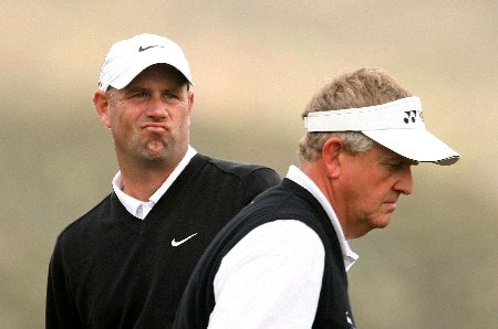 MARANA, AZ - FEBRUARY 22:  Stewart Cink (L) watches his tee shot on the 14th hole as Colin Montgomerie of Scotland passes by during the third round matches of the WGC-Accenture Match Play Championship at The Gallery at Dove Mountain February 22, 2008 in Marana, Arizona.  (Photo by Scott Halleran/Getty Images)