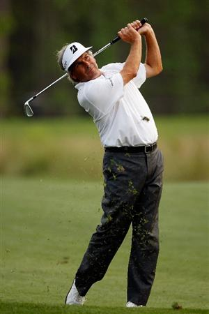 HUMBLE, TX - APRIL 04:  Fred Couples makes a shot from the fairway on the 6th hole during the third round of the Shell Houston Open at Redstone Golf Club April 4, 2009 in Humble, Texas.  (Photo by Chris Graythen/Getty Images)