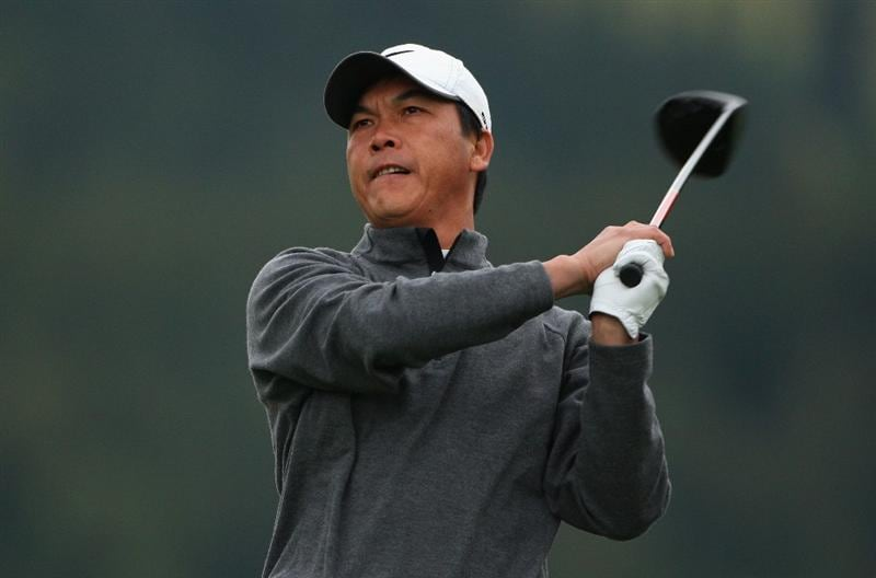 CRANS, SWITZERLAND - SEPTEMBER 04:  Lian-wei Zhang of China watches his tee-shot on the 14th hole during the first round of the Omega European Masters at Crans-Sur-Sierre Golf Club on September 4, 2008 in Crans Montana, Switzerland.  (Photo by Andrew Redington/Getty Images)