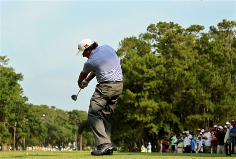PONTE VEDRA BEACH, FL - MAY 13:  Phil Mickelson hits his tee shot on the 15th hole during the second round of THE PLAYERS Championship held at THE PLAYERS Stadium course at TPC Sawgrass on May 13, 2011 in Ponte Vedra Beach, Florida.  (Photo by Mike Ehrmann/Getty Images)