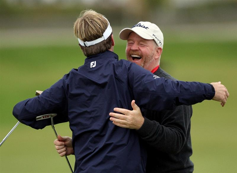 ST.ANDREWS, SCOTLAND - OCTOBER 02:  Brett Quigley of the USA celebrates with his playing partner Tom Hagerty on the 17th tee during the second round of The Alfred Dunhill Links Championship at The Old Course on October 2, 2009 in St. Andrews, Scotland.  (Photo by David Cannon/Getty Images