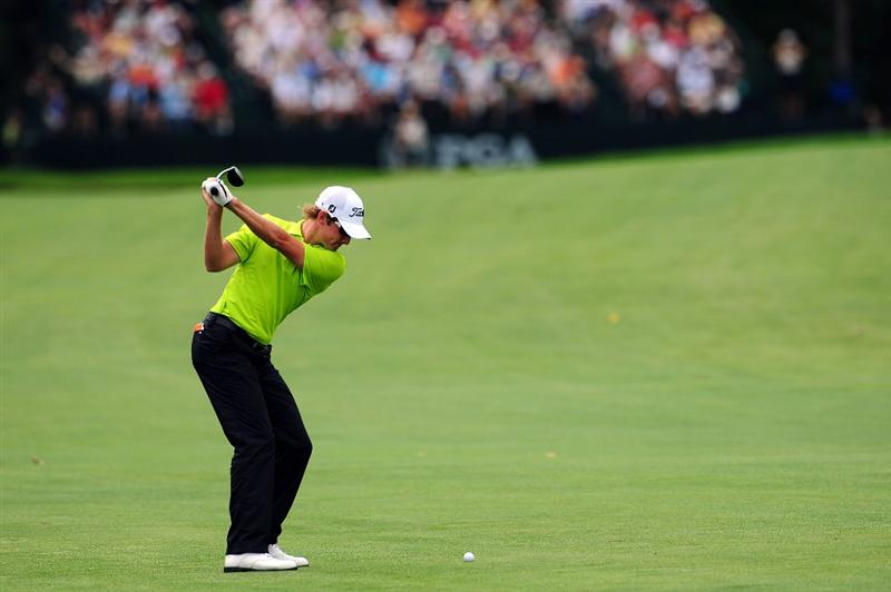 CHASKA, MN - AUGUST 16:  Michael Sim of Australia hits a shot on the 12th hole during the final round of the 91st PGA Championship at Hazeltine National Golf Club on August 16, 2009 in Chaska, Minnesota.  (Photo by Stuart Franklin/Getty Images)