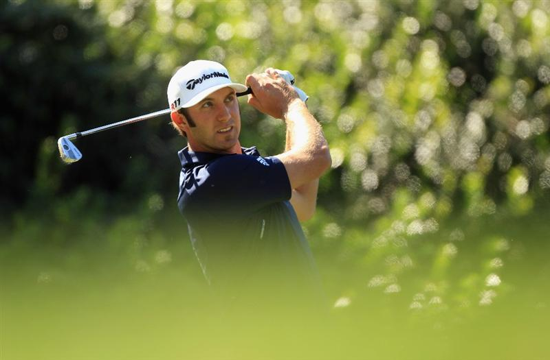 CHARLOTTE, NC - MAY 05:  Dustin Johnson watches his shot on the 13th hole during the first round of the Wells Fargo Championship at Quail Hollow Club on May 5, 2011 in Charlotte, North Carolina.  (Photo by Streeter Lecka/Getty Images)