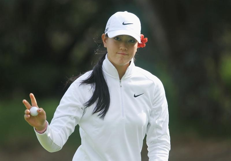 CITY OF INDUSTRY, CA - MARCH 24:  Michelle Wie celebrates a birdie putt on the 11th hole during the first round of the Kia Classic on March 24, 2011 at the Industry Hills Golf Club in the City of Industry, California.  (Photo by Scott Halleran/Getty Images)